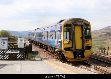 Northern operated class 158 express sprinter 158 868 still in its old Scotrail livery at Garsdale on Settle to Carlisle railway line 30th April 2019. - Stock Photo