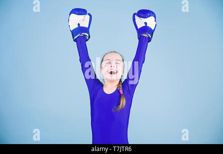 Risk of injury. Female boxer change attitudes within sport. Rise of women boxers. Girl cute boxer on blue background. With great power comes great responsibility. Boxer child in boxing gloves. - Stock Photo