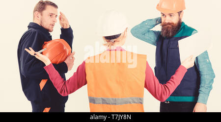 Misunderstanding concept. Builders and engineer arguing, misunderstanding. Team of architects, engineers discussing work, arguing, isolated white background. Men in hard hats and uniform and woman. - Stock Photo