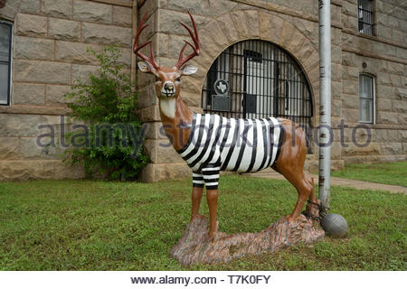 Public Art Texas Hill Country. Folk Art Texas Hill Country. Prisoner Deer Llano Texas. Fugitive Deer Texas Hill Country. Prison Stripes. Jail Stripes. - Stock Photo