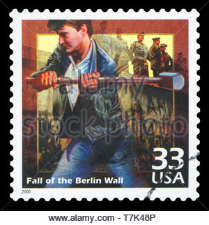 UNITED STATES OF AMERICA - CIRCA 2000: a postage stamp printed in USA showing an image of the fall of Berlin Wall, circa 2000. - Stock Photo