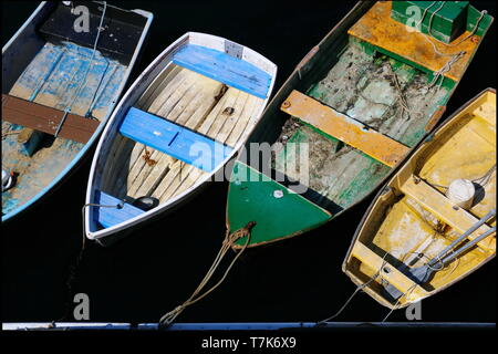 several colorful dinghies anchored to the dock - Stock Photo