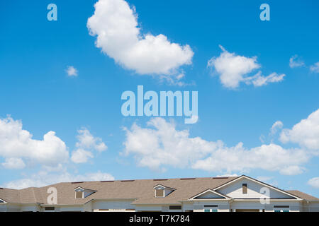 house roof on blue sunny sky background. Architecture and structure. design concept. rent an apartment. relocation. moving to a new house. Rooftop. Protection and shelter. Promoting safety for life. - Stock Photo