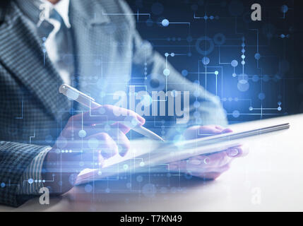 Business man works in office with tablet computer - Stock Photo