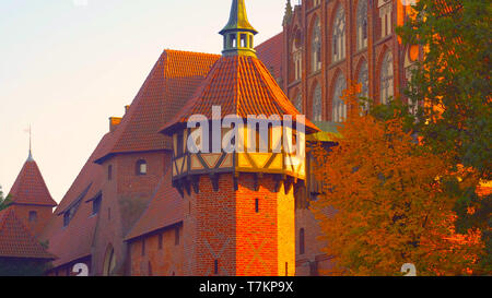 The roof of an old building in Poland. The color of the wall is red in the traditional style - Stock Photo
