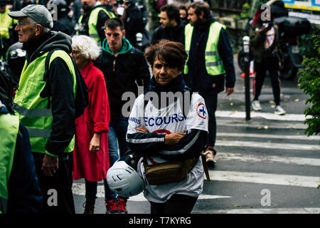 Paris France May 04, 2019 View of French street medic walking in the street during protests of the Yellow jackets - Stock Photo