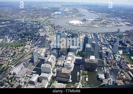 The financial district of Canary Wharf London taken from the air and looking down the river Thames towards Greenwich  and the O2 arena - Stock Photo