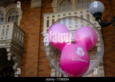 Orlando, Florida. April 02, 2019. Magenta Mickey Mouse balloon in Magic Kingdom at Walt Disney World  (1) - Stock Photo