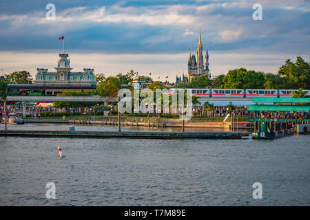 Orlando, Florida. April 02, 2019. Monorail and panoramic view of Cinderella's Castle and vintage Train Station at Magic Kingdom in Walt Disney World - Stock Photo