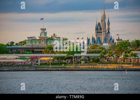 Orlando, Florida. April 02, 2019. Panoramic view of Cinderella's Castle and vintage Train Station at Magic Kingdom in Walt Disney World - Stock Photo
