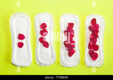 Female's hygiene products on the yellow background. Concept of critical days, menstrual cycle, period days, PMS - Stock Photo