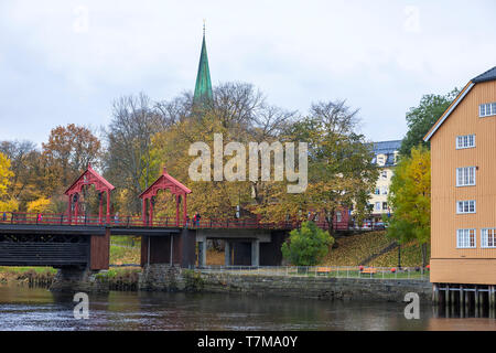 The spire of the cathedral and the Old Town Bridge (Gamle Bybro), over the Nidelva River, Trondheim, Trøndelag, Norway - Stock Photo