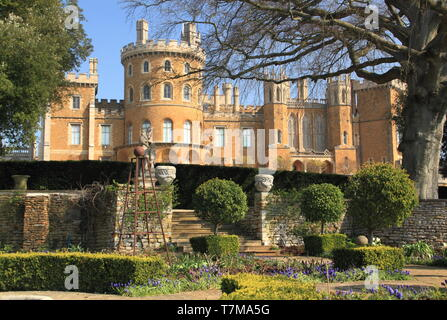 Belvoir Castle, an English stately home, seen from the formal rose garden in spring, Leicestershire, East Midlands, UK - Stock Photo