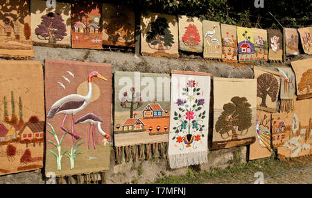 Woven and embroidered wall hangings for sale in Kathmandu, Nepal - Stock Photo