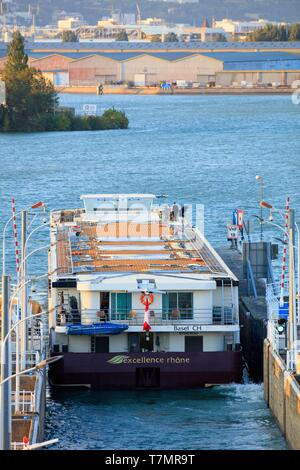 France, Rhône, Saint Fons, cruise on the Rhone, Centrale and Pierre Bénite lock, port of Lyon Edouard Herriot in the background - Stock Photo