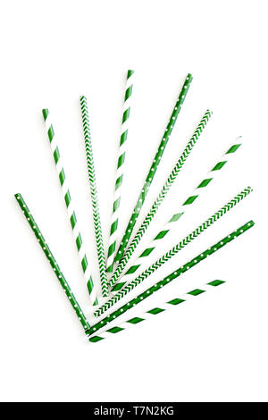 Eco friendly paper straws in a variety of green and white dots, stripes and zig zags.  Isolated on white background in vertical format. - Stock Photo