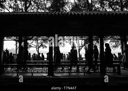 Many people in Beijing & they all like to walk, a black & white silhouette, China Stock Photo