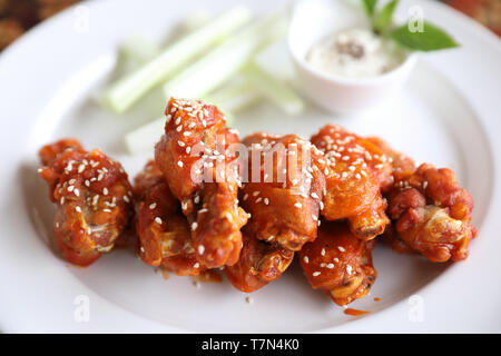 buffalo wings , Fried chicken with hot and spicy sauce - Stock Photo
