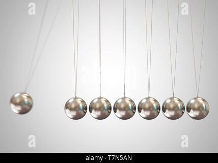 Silver Balancing balls Newton's cradle - Stock Photo