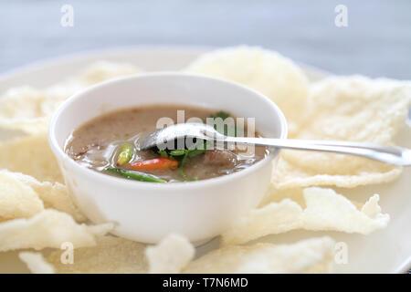 Thai food rice crust with pork white sauce - Stock Photo
