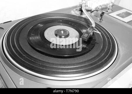 This is and old and antique turntable captured in black and white and you can see the scratches and old material of the player - Stock Photo