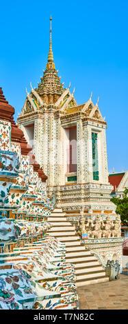 Beautiful closeup view of War Arun a Buddhist temple in Bangkok Yai district of Bangkok, Thailand. Vertical panorama. Focus on the foreground, shallow - Stock Photo