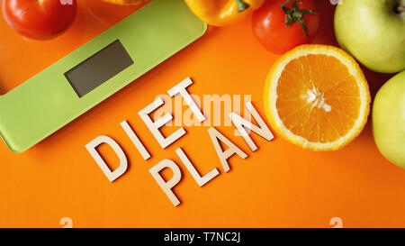Concept diet. Healthy food, kitchen weight scale. Vegetables and fruits lettering Diet plan - Stock Photo