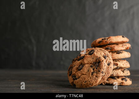 Stack of tasty chocolate chip cookies on wooden background. Space for text - Stock Photo