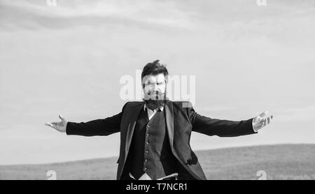 Self proud and narcissistic. Hipster bearded attractive enjoy freedom. Guy enjoy top achievement. Man bearded proud himself sky background. Superiority and power. Feeling undefeated. Proud of himself. - Stock Photo