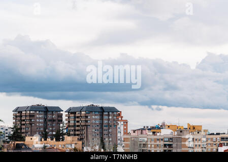 Cityscape of residential district of Madrid against cloudy sky. Ciudad Lineal, Madrid, Spain - Stock Photo