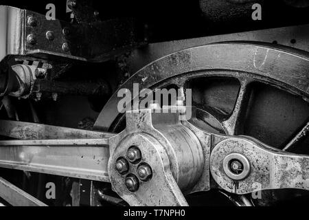 Black and white close-up photograph of steam locomotive driving mechanism. - Stock Photo