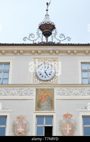 MONDOVI, ITALY - AUGUST 16, 2016: Building facade with clock, bell and Virgin Mary fresco in a summer day in Mondovi, Italy. - Stock Photo