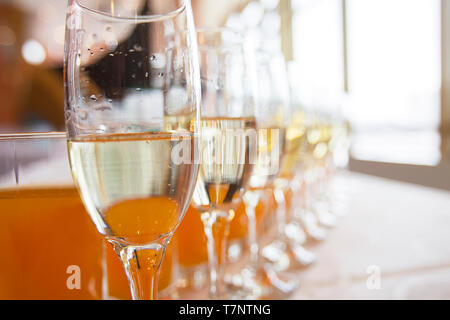 Champagne glasses in a row - Stock Photo