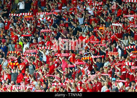 Crowd of Liverpool supporters show their support during the UEFA Champions League Final 2018 game against Real Madrid - Stock Photo