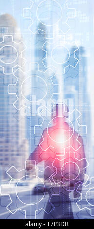 Vertical Panorama Banner. Double exposure gears mechanism on blurred background. Business and industrial process automation concept. - Stock Photo
