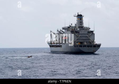 190505-N-SB587-0992 South China Sea (May 5, 2019)  Sailors from the Mine Countermeasure Ship USS Pioneer (MCM 9) approach the fleet replenishment oiler USNS Walter S. Diehl (T-AO 193) in a Rigid Hull Inflatable Boat during a replenishment-at-sea to receive cargo. Pioneer, part of Mine Countermeasures Squadron 7, is operating in the U.S. 7th Fleet area of operations to enhance interoperability with partners and serve as a ready-response platform for contingency operations. (U.S. Navy photo by Mass Communication Specialist 2nd Class Corbin J. Shea) - Stock Photo