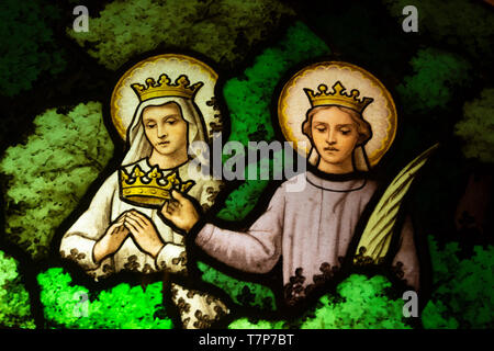 Detail of a stained glass window (king and queen) - Stock Photo