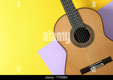 Beautiful classic guitar on two tone background, space for text - Stock Photo