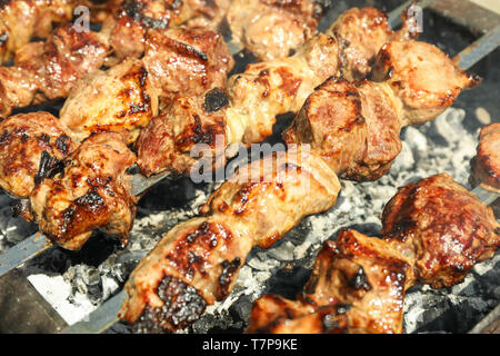 Meat skewers on grill as background, closeup. Outdoor kitchen - Stock Photo