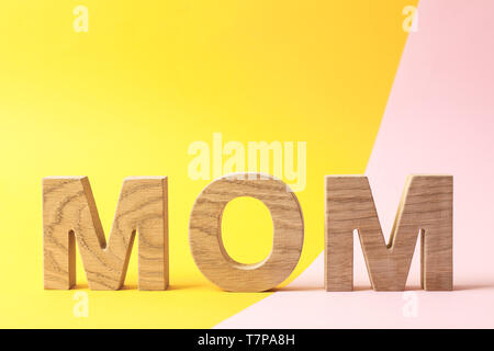 Inscription mom on two tone background, space for text - Stock Photo