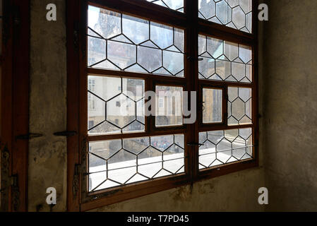 stained glass windows in the gothic style  inside the Prague Castle - Stock Photo