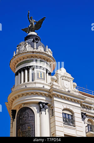 Architectural detail of the 'Union and the Phoenix' building in the central 'Plaza de las Tendillas' against blue skies - Stock Photo
