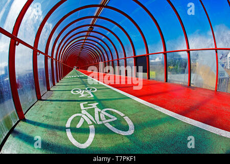 Interior of red tunnel with cycle path and pedestrian bridge in Glasgow