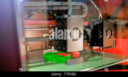 3D printing machine printing plastic model - Stock Photo