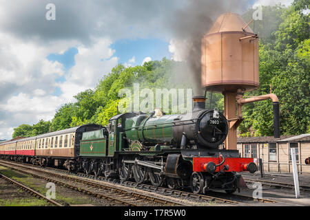 Vintage UK steam train, front view, on the railway track awaiting departure from Severn Valley Railway, Bewdley station on a sunny summer afternoon. - Stock Photo