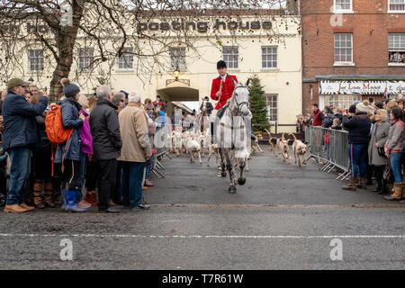 Bawtry, South Yorkshire, United Kingdom, December, 25th, 2018: The start of the Boxing Day Hunt, leading off from Bawtry market square, lone horseman with dogs - Stock Photo