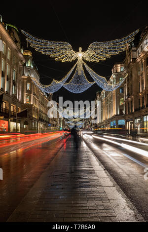 The angel shaped Christmas lights on regents street 2018, long exposure with bus and car light trails - Stock Photo