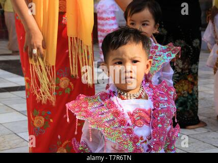 MANDALAY, MYANMAR - DECEMBER 18. 2015: Novitiation ceremony (Shinbyu) for young Buddhist boy at Maha Muni Pagoda - Stock Photo