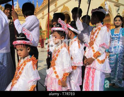 MANDALAY, MYANMAR - DECEMBER 18. 2015: Novitiation (Novitiate) ceremony (Shinbyu) for young Buddhist boy at Maha Muni Pagoda - Stock Photo