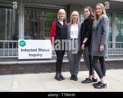 Fiona Rennie at the Infected Blood Inquiry with her Triplets, Molly, Maddy and Meghann, born after IVF treatment. - Stock Photo
